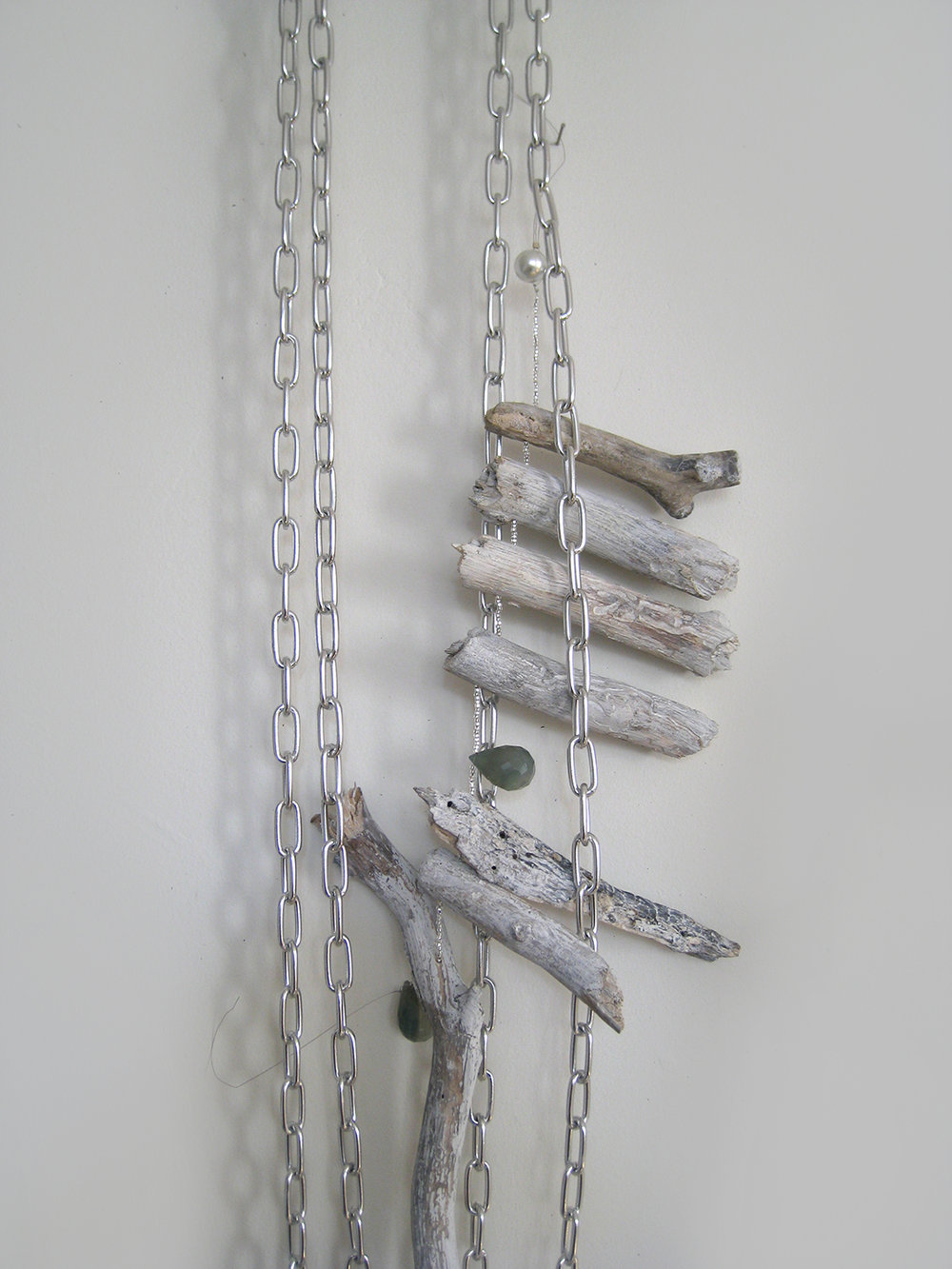 "Iron Tongue Milks the Girl, Me As A Goddess 3"", 2009. Aprox. 6' long. Steel chain and tag, Chalcedony stone, glass beads, drift wood."
