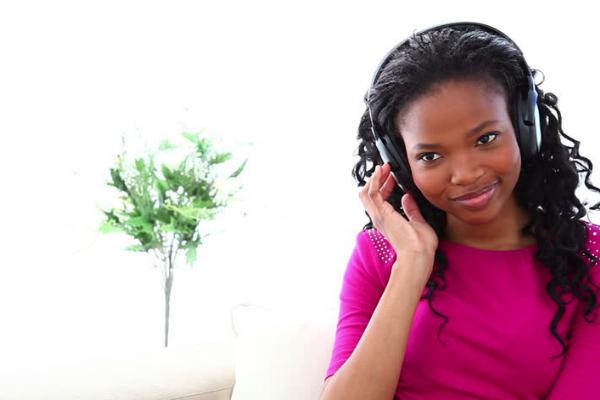 Girl Listening to Headphones.png