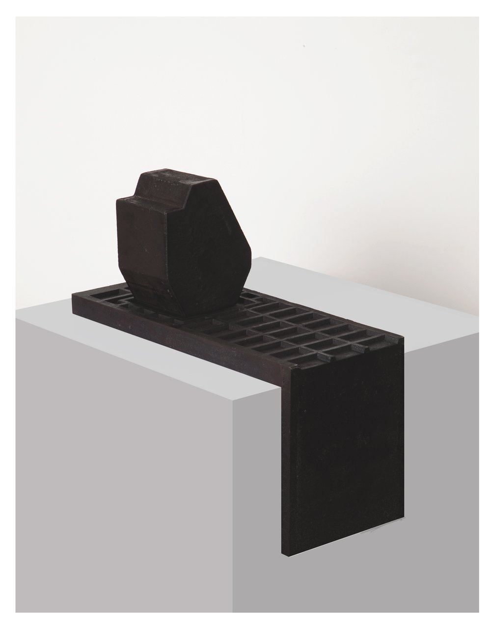 Seher Shah  Untitled (monolith and corner grid),  2015, Cast iron, 16 x 16 x 7 in (41h x 40w x 18d cm) 31 kgs.