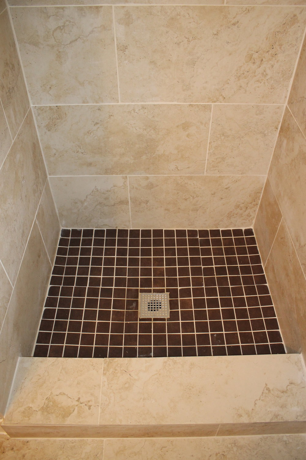 After - added a pop of chocolate brown to the shower floor...why the heck not?
