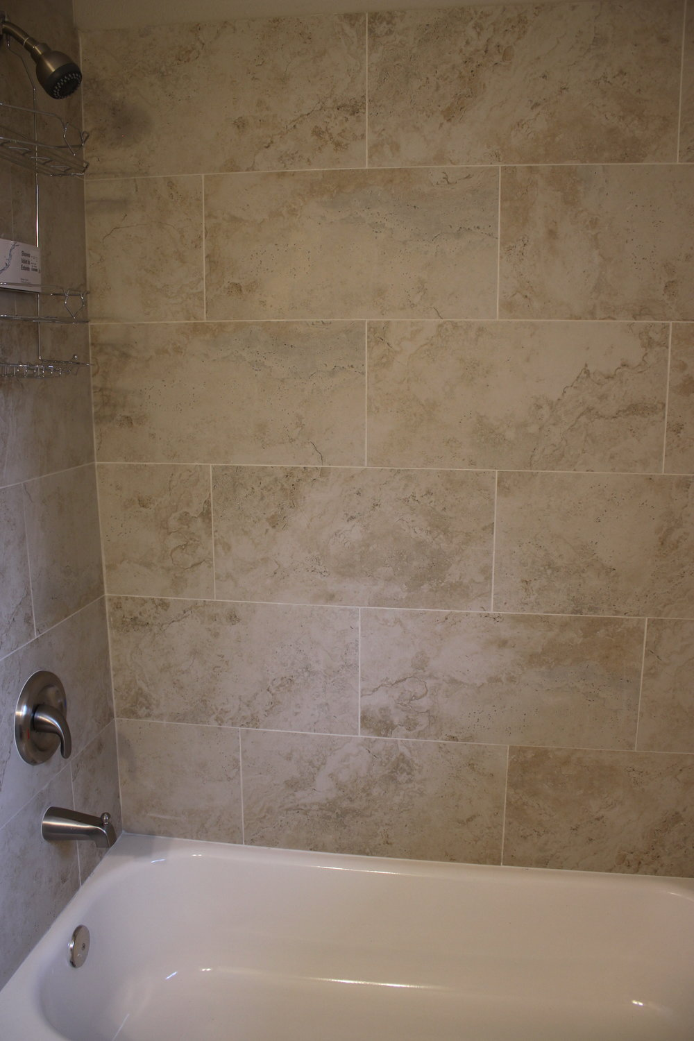 After - laying tile in a subway pattern gave the shower wall some interest and sophistication