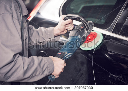 stock-photo-auto-mechanic-buffing-car-autobody-397957930.jpg