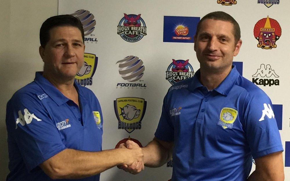 (Photo: Capalaba FC's Shaun McAney welcome Steve Duncan as JDOC)