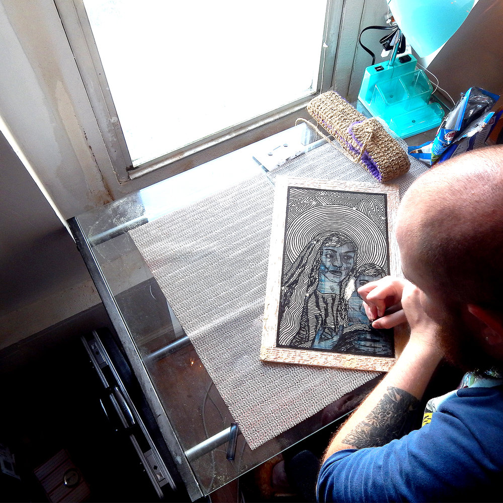 Craig E. Ross working in their studio