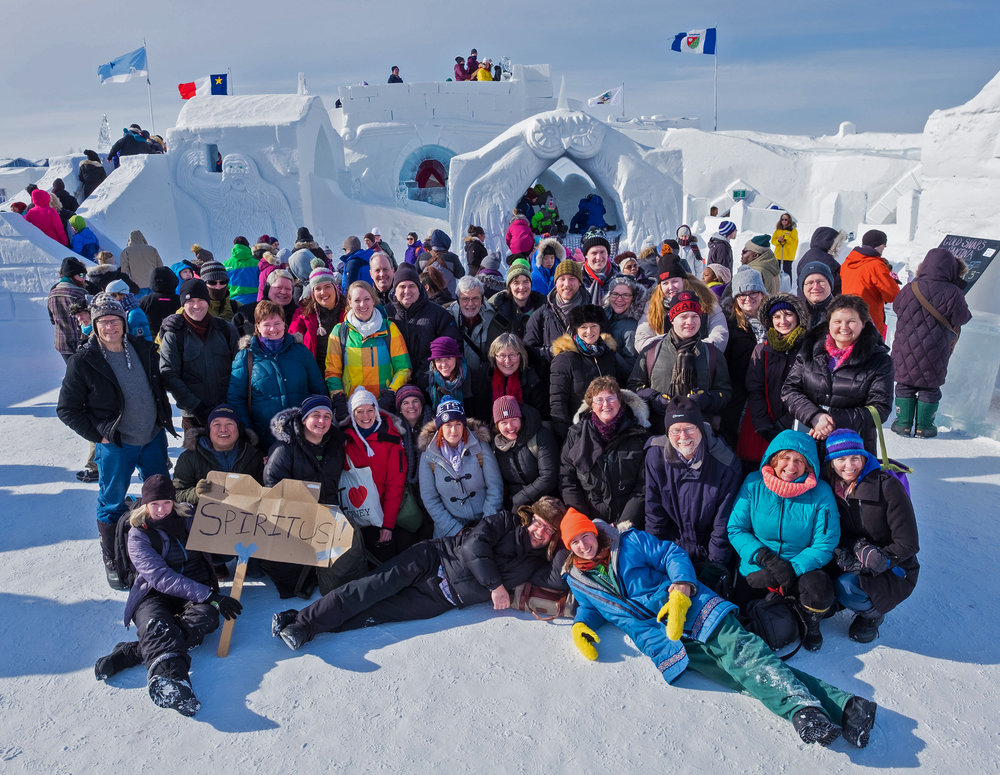 Spiritus joined by composer Carmen Braden and members of the string ensemble, pose for a group shot at the famous Snow Palace.