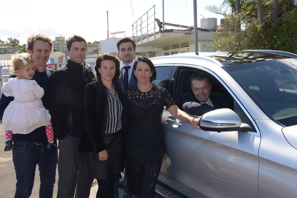 Madeline Tynan-Davey and her family Tim, Poppy, Nicholas, Prudence, Samuel, with Brian Barry from Tynan Motors