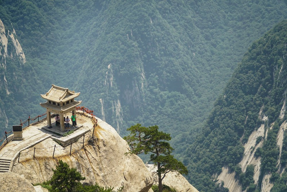 Hikers rest on during the treachurous ascent of Huashan, China.