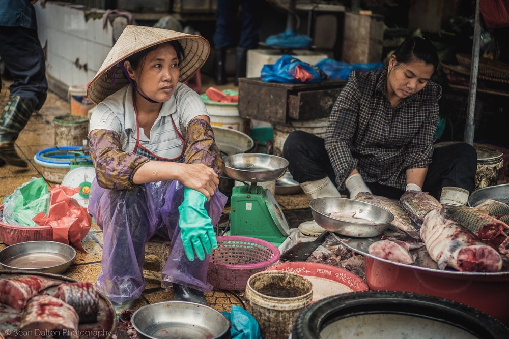 A woman sells fresh fish on the streets of Hanoi, Vietnam.