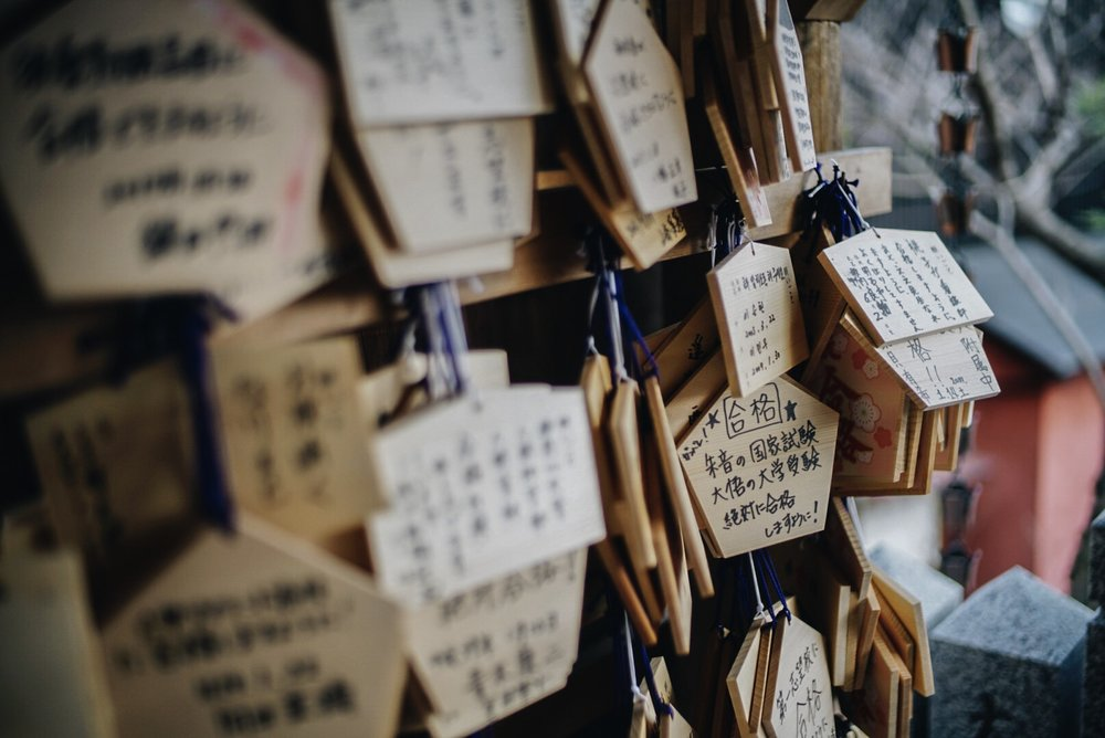 Wishes scribed on wood panels at a shrine in Kobe, Japan.