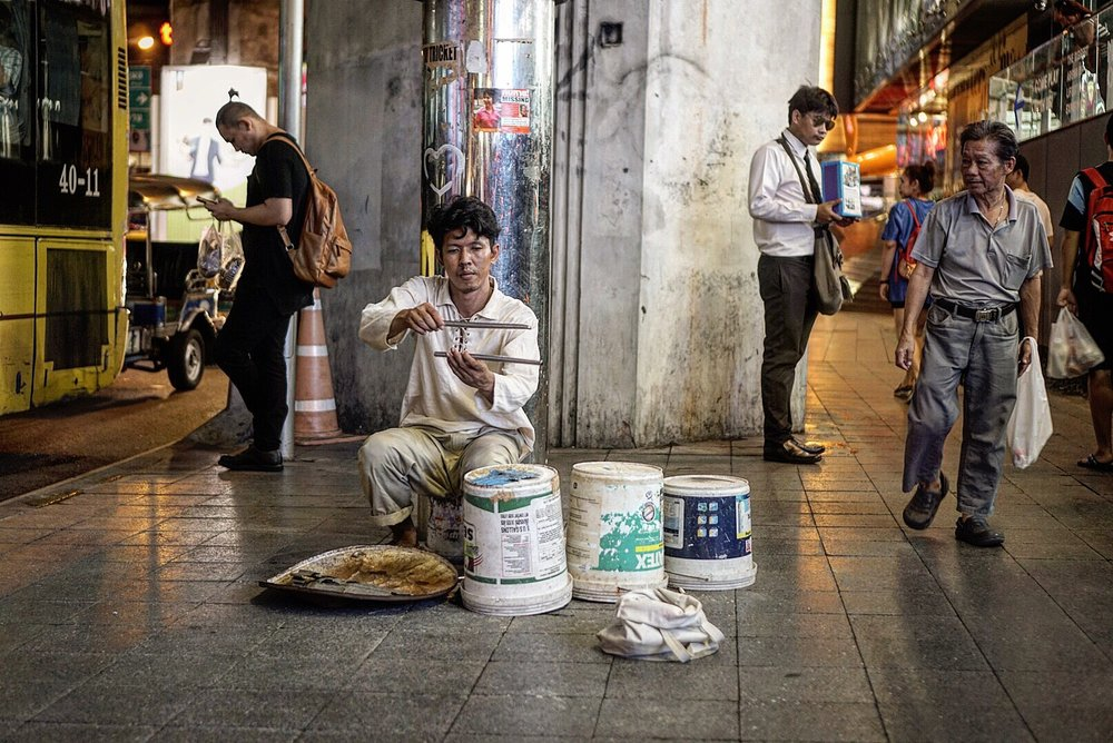 A man prepares for his night of entertainment on the streets of Bangkok, Thailand.