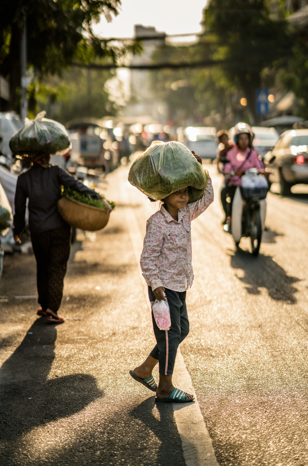 A young girl crosses the street in Phnom Penh, Cambodia.