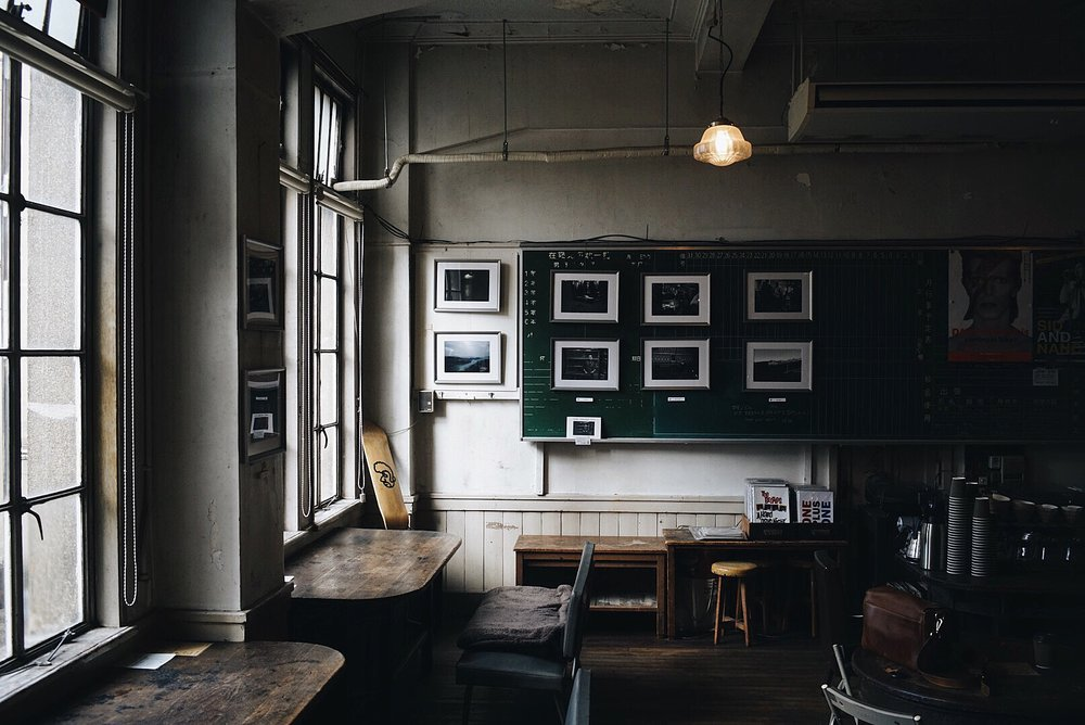 An example of a perfect setting for food photography. Notice the soft light entering through the windows and reflecting off of the dark wooden table.
