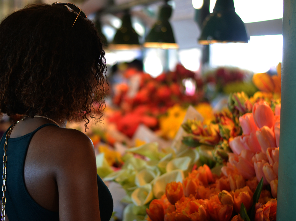 Looking at all of the beautiful flowers inside of Pike Place Market!