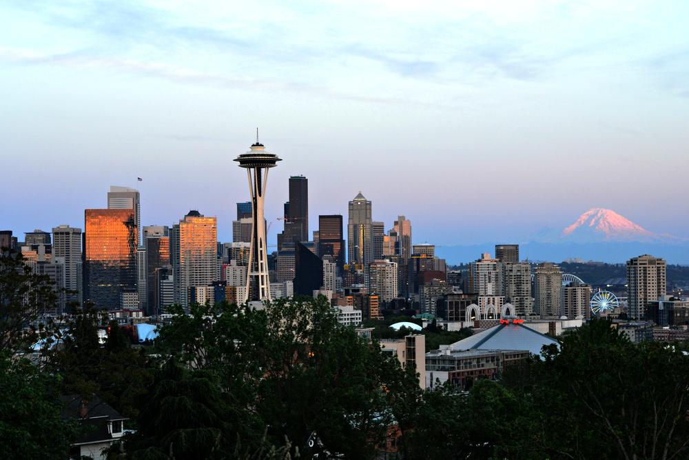 An Amazing sunset view at Kerry park featuring the Seattle Skyline and Mount Rainier!