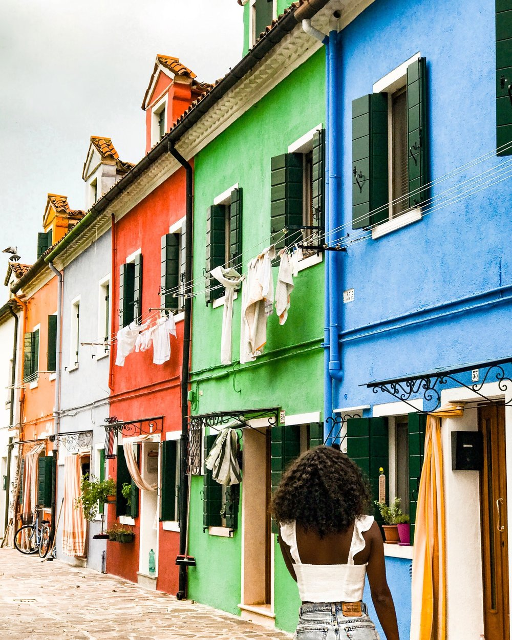 This photo was taken in Burano, Italy using an iPhone. I met a solo traveler on the bus ride there and we spent the entire day together.