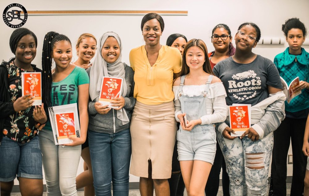 Pictured with the Summer 2018 Girls Cohort of the Success Beyond Limits Program. Image Credit SBL