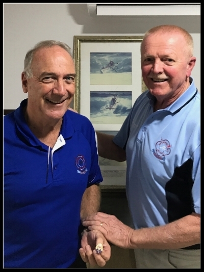 Stephen Maitland OAM RFD (left) being presented with his Life Member badge by Club President Mike McDonald at the AGM on Sunday 19 June 2017.