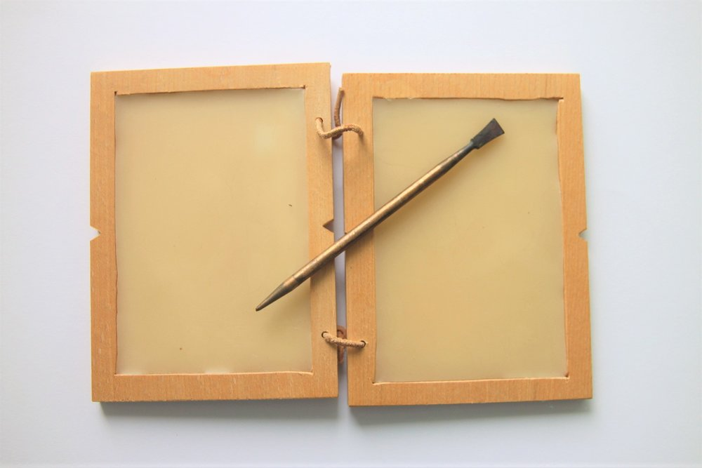 Wax tablet with stylus, photo Peter van der Sluijs