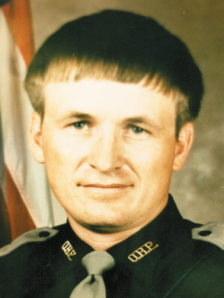 Trooper Randy Littlefield    January 15, 1990   Littlefield joined the OHP in 1984. Trooper Littlefield came upon a stalled vehicle on Highway 20, east of Jay. He proceeded to direct traffic around the stalled vehicle. While attempts were being made by the disabled motorist to restart his vehicle, a car driven by a 68 year-old man struck Littlefield, knocking him under the car being used to jump-start the stalled vehicle. The force of the impact moved the vehicle with Littlefield under it, 75 feet down the road. Littlefield was dead on arrival at Grove Memorial Hospital a short time later. The driver, Ross England, was convicted of first- degree manslaughter.