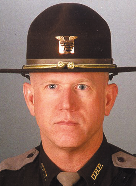 "Trooper Rocky Eales    September 24, 1999   Eales joined the patrol in 1979. Trooper Eales, was shot and killed while assisting the DA's drug task force in Sequoyah County while attempting to serve felony warrants on September 24. Members of the OHP Tactical Team arrived at a residence near Sallisaw to serve a warrant. Upon approaching the residence Troopers John M. ""Buddy"" Hamilton and David W. ""Rocky"" Eales were fired upon. Trooper Hamilton received non- fatal wounds to both shoulders and left eye. Trooper Eales received a fatal wound and expired at the scene. Kenneth Eugene Barrett, 38, is being charged with murder and shooting with intent to kill."