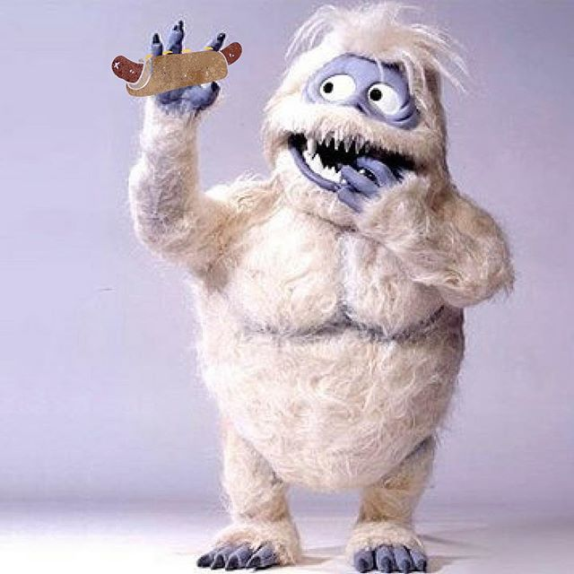 Sorry, everyone - we might be partially to blame for this rough winter. This guy found out about our hot dogs and keeps showing up for more. #bumble #abominablesnowman #lemmegetawolfboy #thisiscle #hotdog #biggestfan