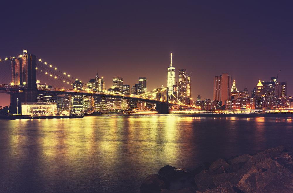 Retro toned New York waterfront at night, USA..jpg