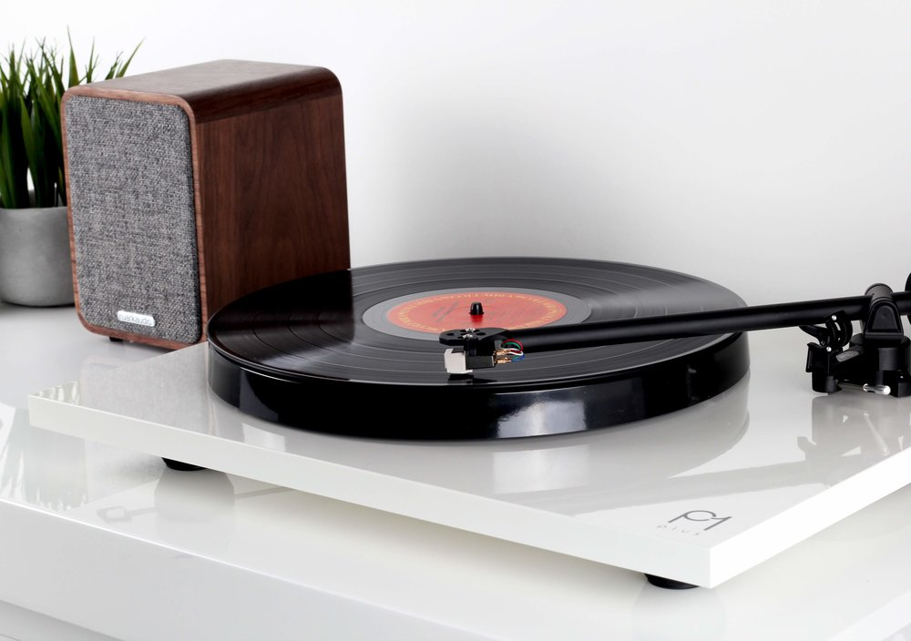 Simply hook up your table to some active speaker (or a line level RCA input)