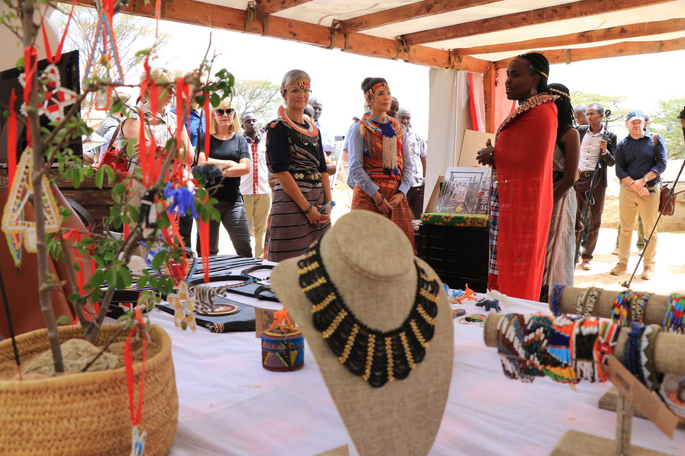 BeadWORKS production manager, Beatrice Lempaira briefing her royal highness on the business.