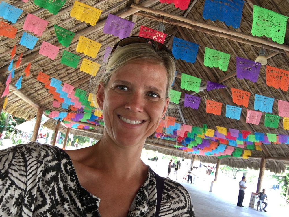 "Colorful ""papel picado"" line the central plaza in the old town of El Cedral on the island of Cozumel, Mexico."