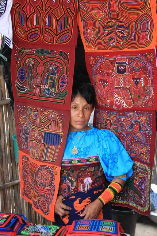 An artist from the Kuna tribe displays her handmade molas in the San Blas Islands of Panama.