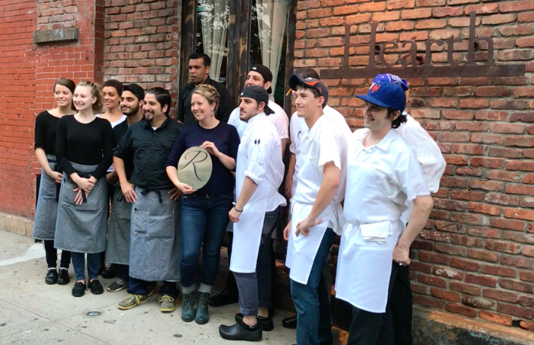 The team at Hearth—wine director and general manager Christine Wright stands in the middle holding their Renzell plaque.