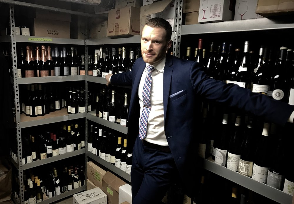 Smith shows off the selection in Sushi Nakazawa's wine cellar.