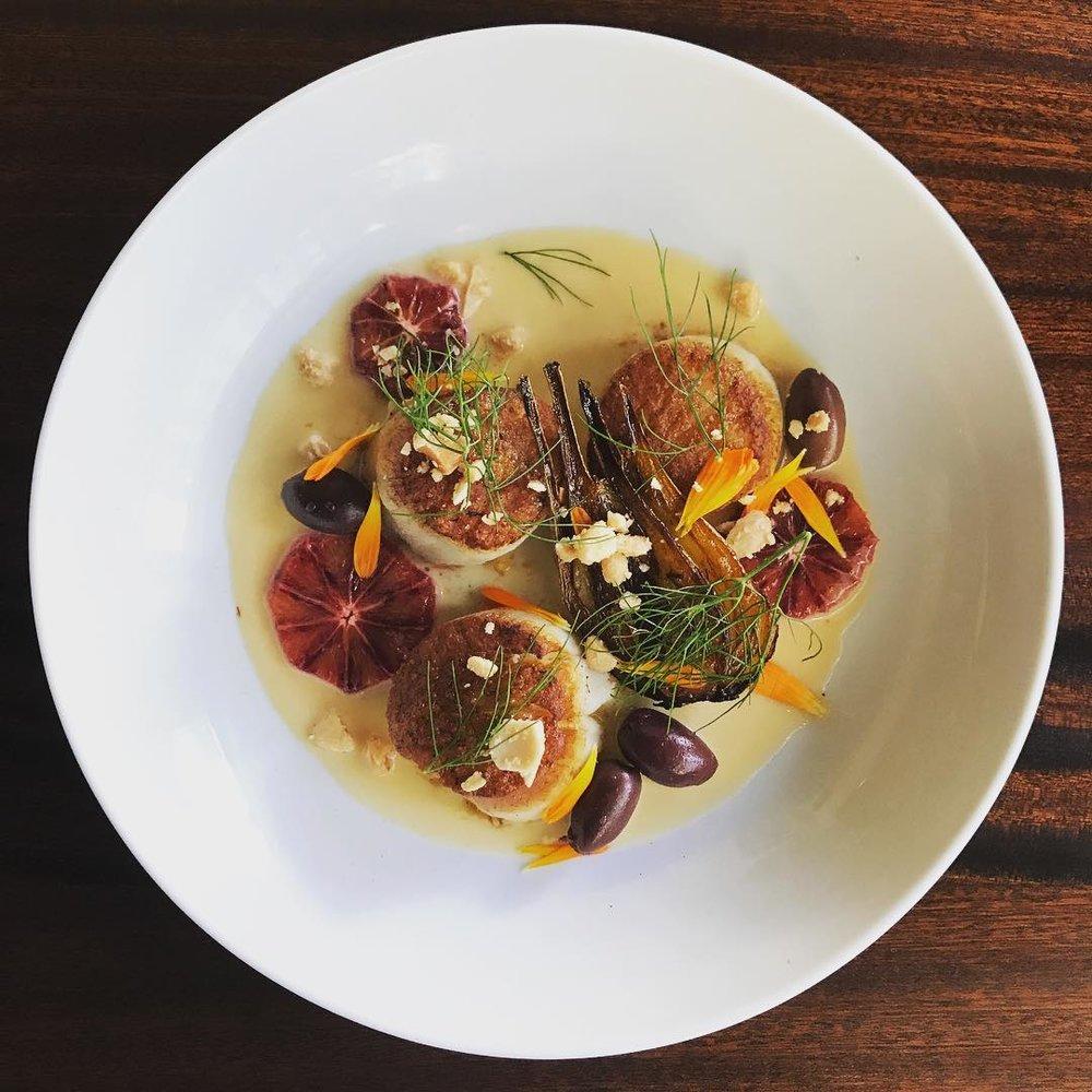Lecosho's Scallops served with blood orange beurre blanc, marcona almond, kalamata olive and calendula flowers. Source: @lecosho.