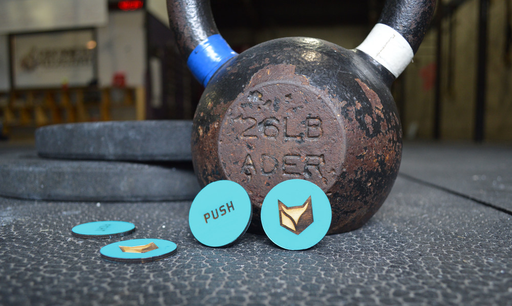Feral has custom chips for keeping track of the reps in workouts. Each chip has a different motivational word laser engraved on one side to keep it's customers pushing the intensity level.