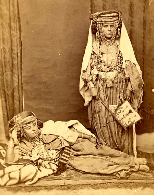 "by Auguste Maure, 1875 <u><a href=""https://commons.wikimedia.org/wiki/File:Auguste_MAURE-Femmes_Algeriennes.JPG"">via</a></u> Wikimedia Commons"