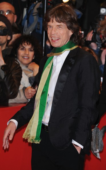 A delicate green and gold striped scarf. Photo: Pascal Le Segretain/Getty Images Europe.
