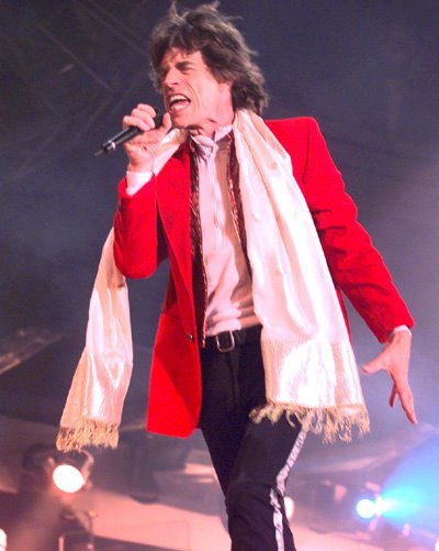 A light pink scarf with tassels worn on stage. Photo: unknown.