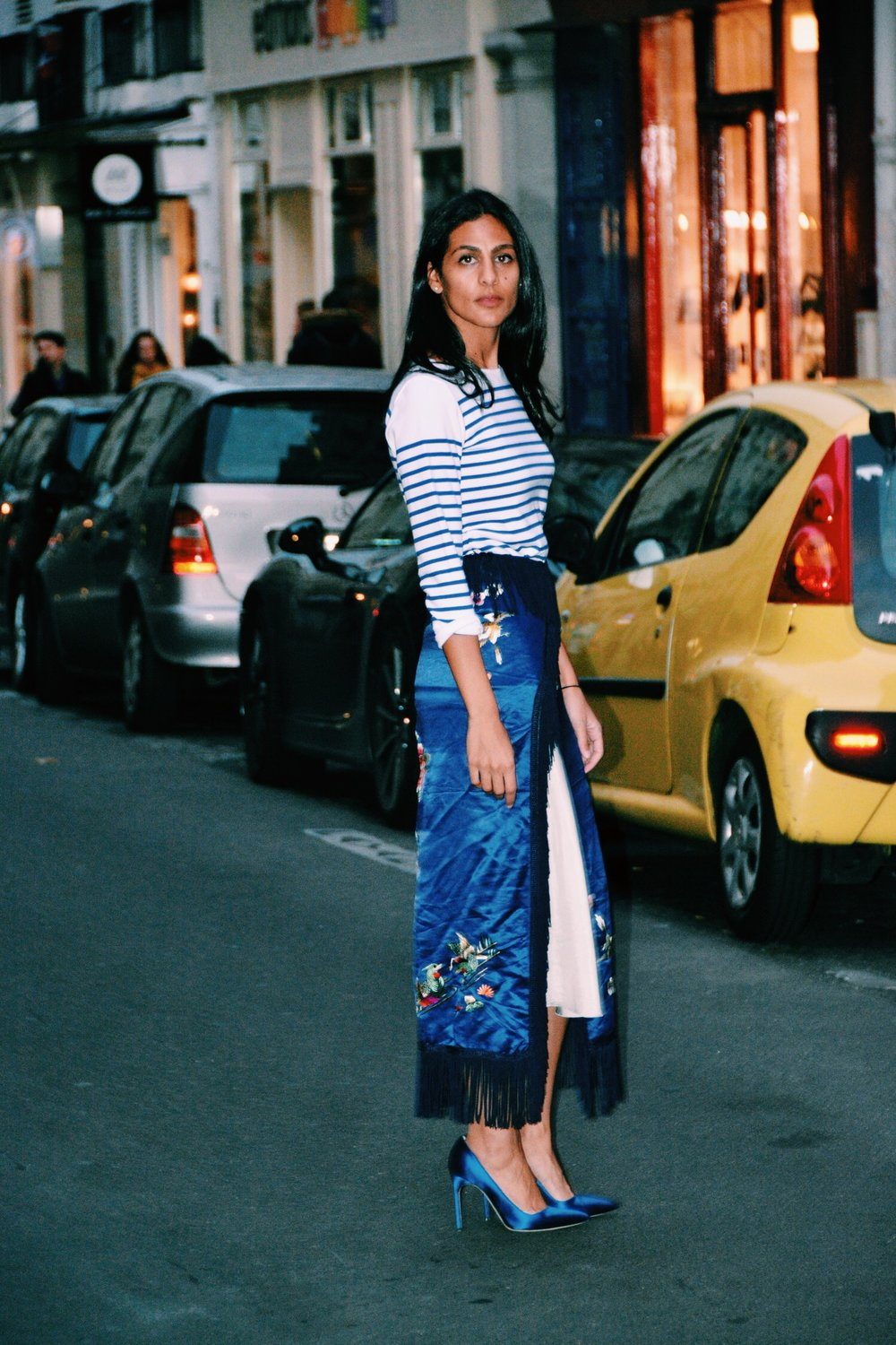 This royal blue Chinese silk throw would not have made the cut in my closet earlier this year. Neither would the shoes. The stripes, yes. Photo: Sherif Farag.
