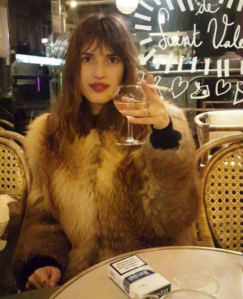 Santé. Here's to Jeanne Damas being very French in a fur coat.