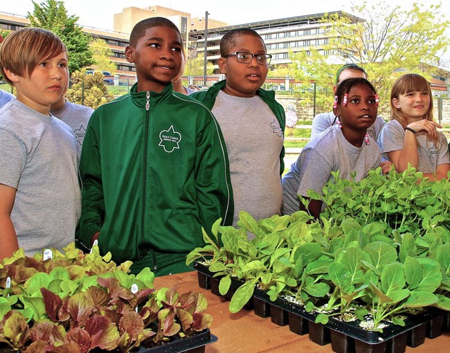 Students at the Lankenau Medical Center's Deaver Wellness Farm learning about product. Photo: Lankenau.