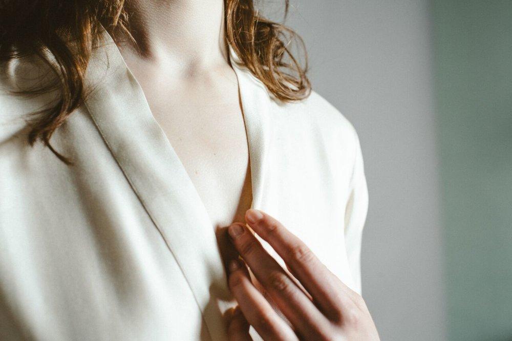 Ivory silk robe.