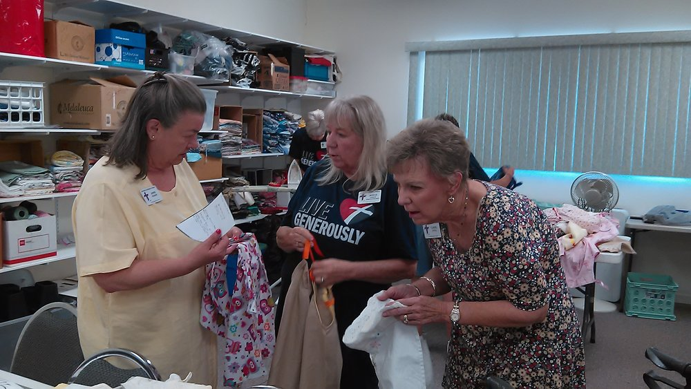 Anne, Joyce, & Carol D picking their dresses.jpg
