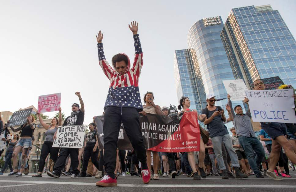 MARCHING FOR POLICE REFROM IN THE AFTERMATH OF PHILANDO CASTILE, ALTON STERLING, AND THE DALLAS 5 SHOOTING ALONGSIDE BLACK LIVES MATTER AND UTAH AGAINST POLICE BRUTALITY..PHOTO COURTESY OF THE SALT LAKE TRIBUNE