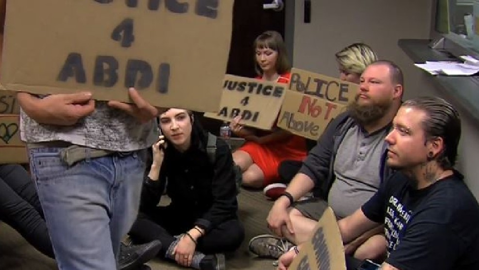 Utah Against Police Brutality holding a Sit-In at Salt Lake DA Sim Gill's office Downtown demanding the charges be dropped against Abdi Mohammed...courtesy of KUTV