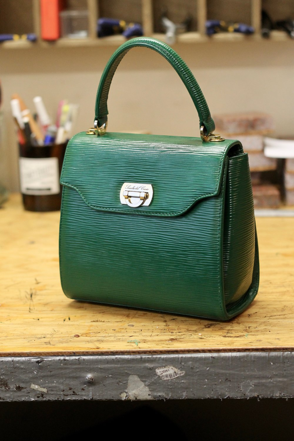 Good as new! The handle was sewn by hand through three layer of leather. This kind of stitch allows the weight of the bag to distributed evenly and helps prevent the seam from tearing.