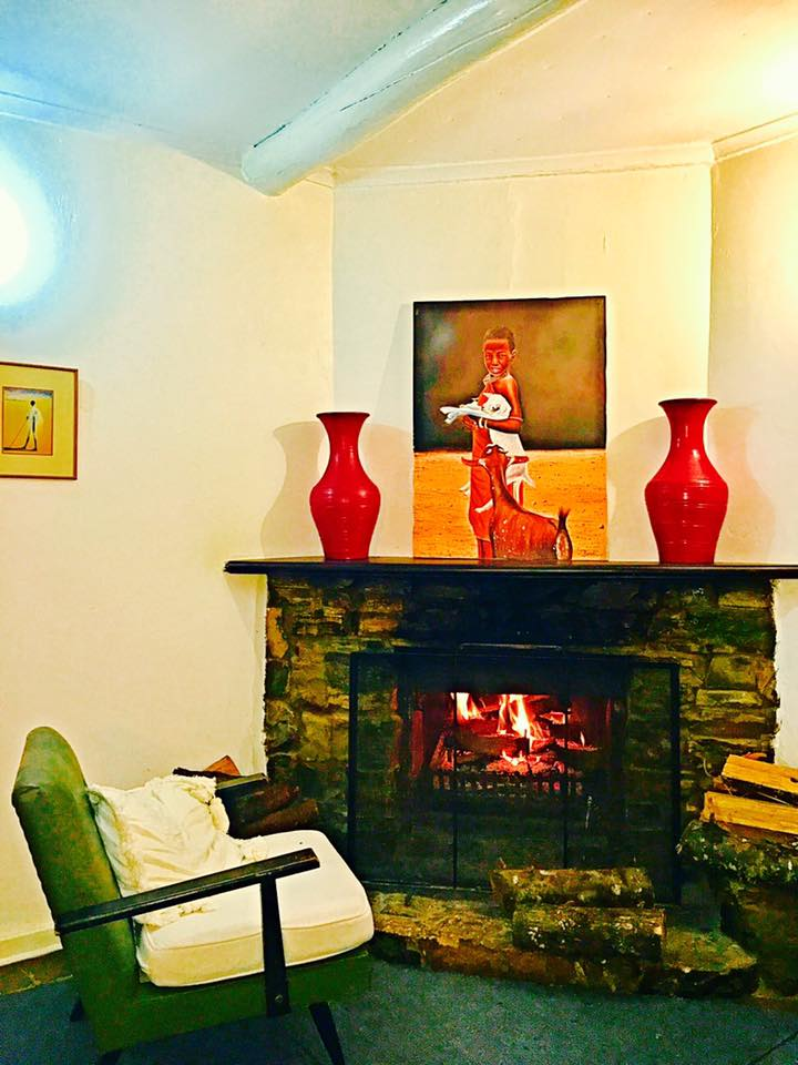 TaiseQua Estate Troutbeck Nyanga Zimbabwe Living room fireplace.jpg