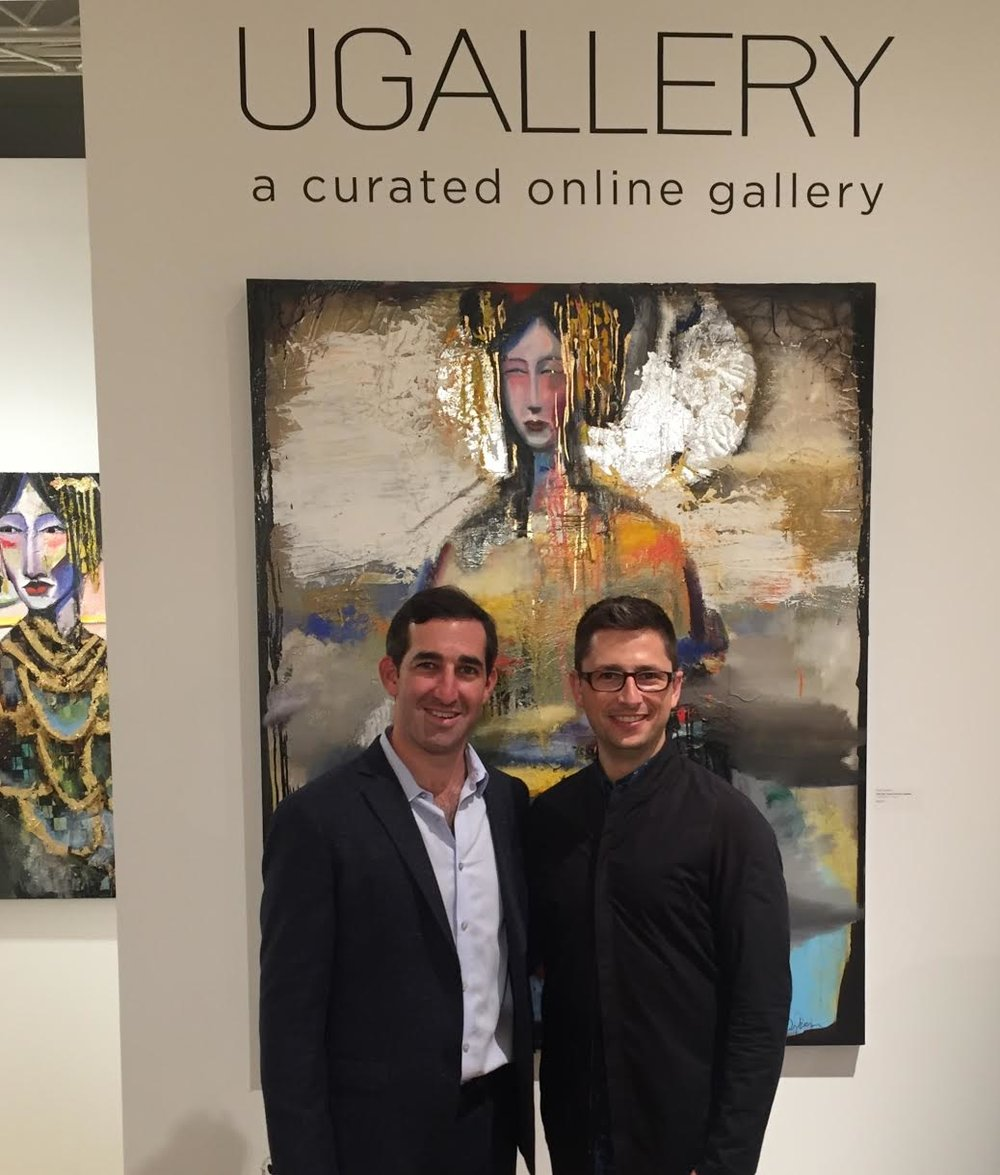 UGallery co-founders Stephen Tanenbaum and Alex Farkas in front of artwork by Scott Dykema