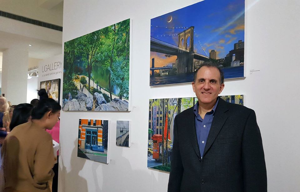Artist Nick Savides in front of his artwork during the opening night private preview.