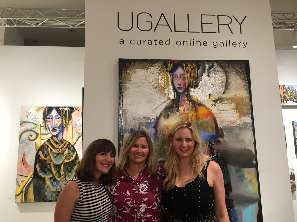 UGallery staff members Samantha Greene (L) and Margaretta Ryan (R) with art consultant, Shirley Rollins (C).