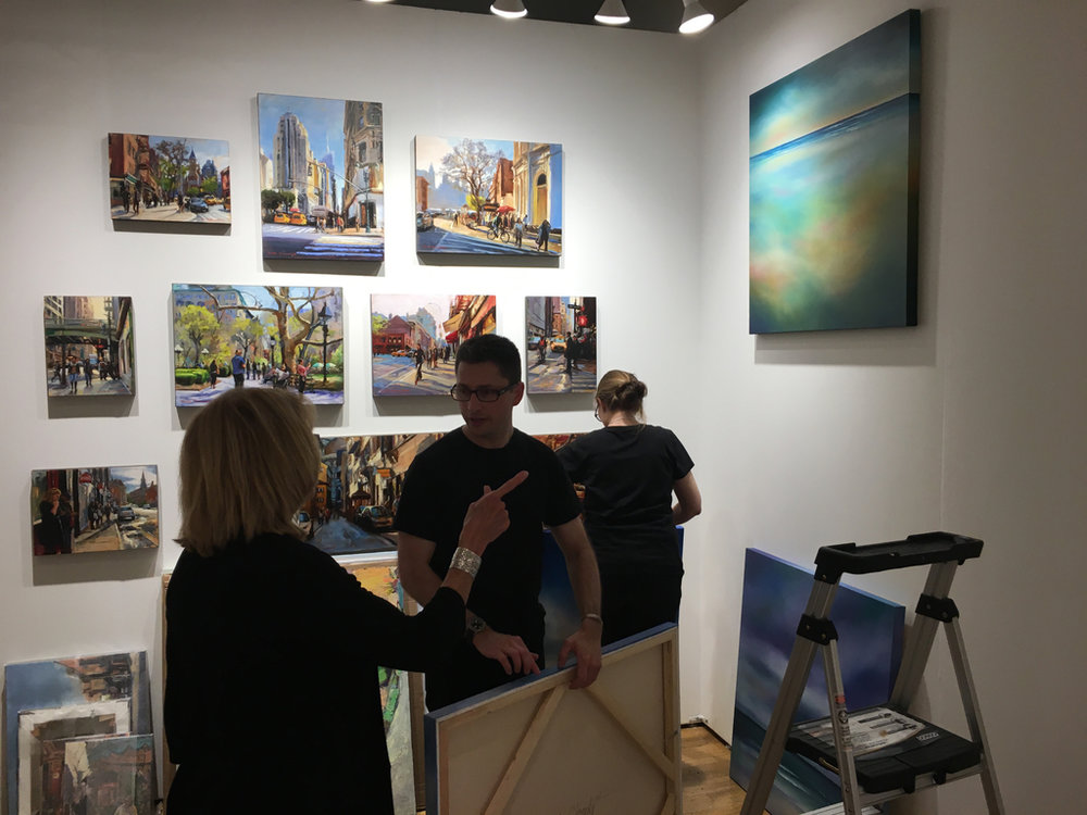 Co-founder and Gallery Director Alex Farkas setting up the UGallery booth at the Affordable Art Fair.